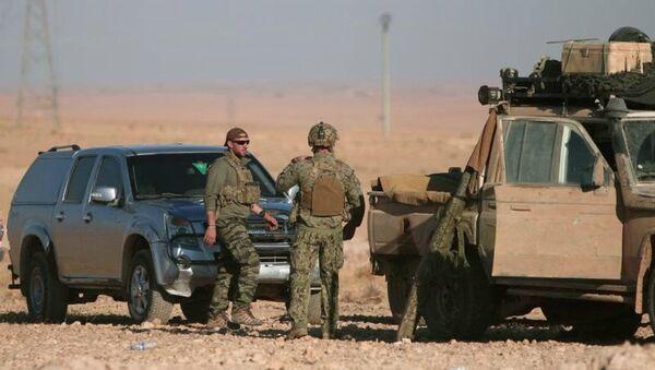 US soldiers stand near military vehicles, north of Raqqa city, Syria. File photo - Sputnik International