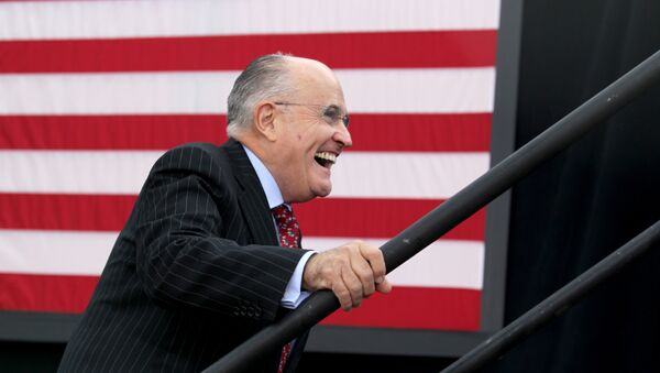 Former New York City mayor Rudy Giuliani smiles as he takes the stage to speak before Republican presidential candidate Donald Trump at an event on October 15, 2016 in Portsmouth, New Hampshire - Sputnik International