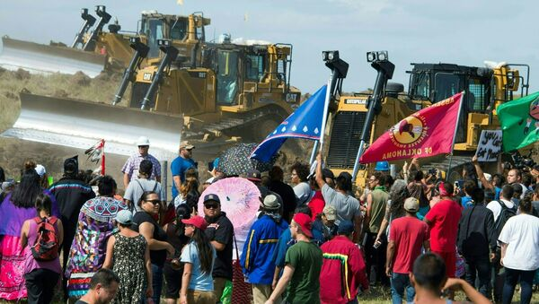 Members of the Standing Rock Sioux Tribe and their supporters opposed to the Dakota Access Pipeline (DAPL) confront bulldozers working on the new oil pipeline in an effort to make them stop, September 3, 2016, near Cannon Ball, North Dakota - Sputnik International