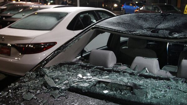Damaged cars sit on a lot after a riot swept through the area in protest to the election of Republican Donald Trump as President of the United States in Portland, Oregon, U.S. November 10, 2016 - Sputnik International