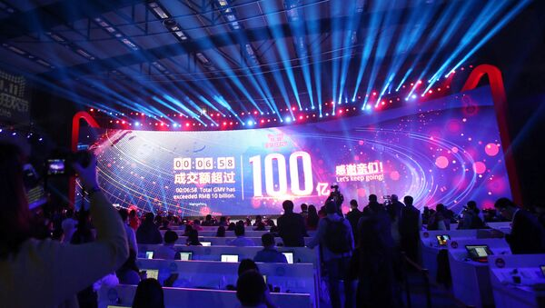 A screen shows real-time data of transactions at Alibaba Group's 11.11 Global shopping festival opening, in Shenzhen, Guangdong province, China, November 11, 2016 - Sputnik International