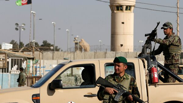 Afghan National Army (ANA) soldiers keep watch outside the Bagram Airfield entrance gate, after an explosion at the NATO air base, north of Kabul, Afghanistan November 12, 2016. - Sputnik International