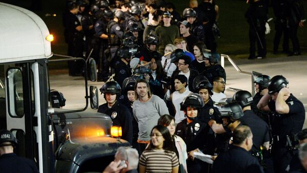 Protestors are detained by Los Angeles Police Department officers after a march and rally against the election of Republican Donald Trump as President of the United States in Los Angeles, California, U.S - Sputnik International