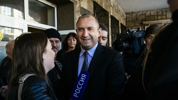 Former head of the Bulgarian airforce Rumen Radev, candidate of the opposition Socialists talks to the media after voting for the presidential elections at a polling station in Sofia - Sputnik International