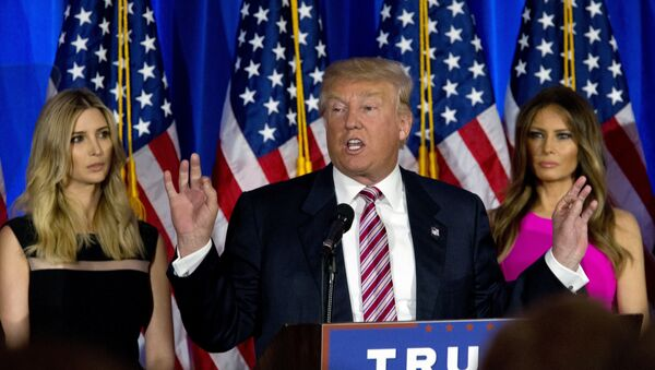 Donald Trump is joined by his daughter Ivanka, left, and wife Melania as he speaks during a news conference at the Trump National Golf Club Westchester, Tuesday, June 7, 2016, in Briarcliff Manor, NY. - Sputnik International