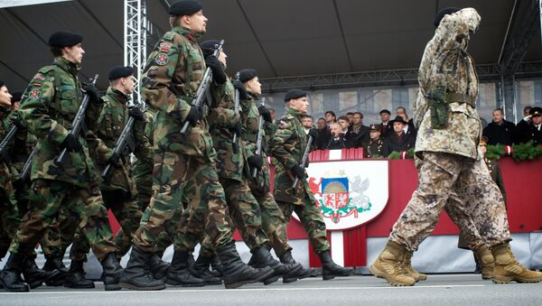 Latvian soldiers march during a military parade on November 18 (File) - Sputnik International