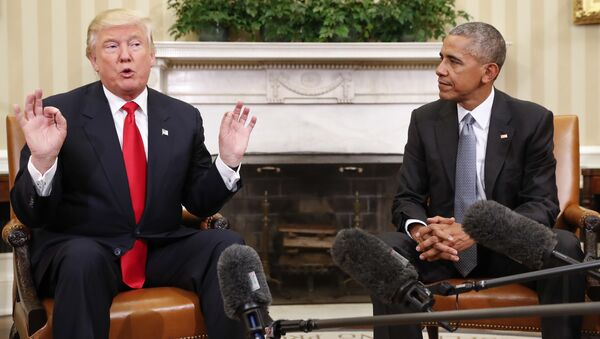 President Barack Obama listens to President-elect Donald Trump speak to members of the media during their meeting in the Oval Office of the White House in Washington, Thursday, Nov. 10, 2016 - Sputnik International