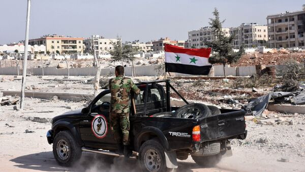 Members of Syrian pro-government forces drive their pick-up in the village of Minyan, west of Aleppo, after they retook the area from rebel fighters on November 12, 2016 - Sputnik International