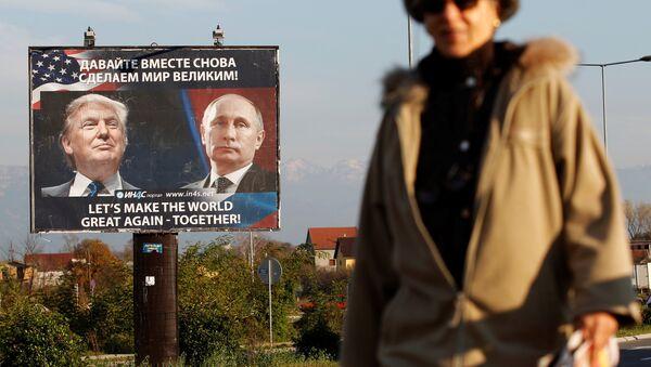 A woman passes a billboard showing a pictures of US president-elect Donald Trump and Russian President Vladimir Putin in Danilovgrad, Montenegro, November 16, 2016 - Sputnik International