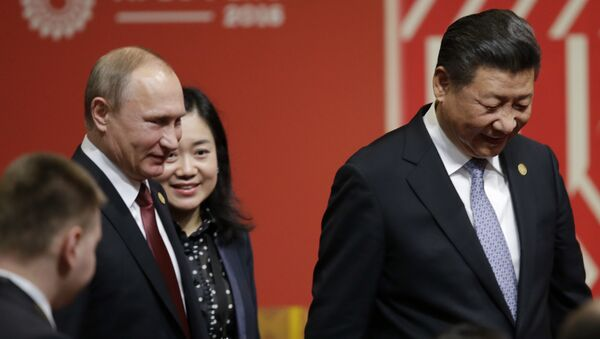 Russia's President Vladimir Putin, left, and China's President Xi Jinping, leave after a meeting with business leader during the annual Asia Pacific Economic Cooperation, APEC, Summit in Lima, Peru, Saturday, Nov. 19, 2016. - Sputnik International