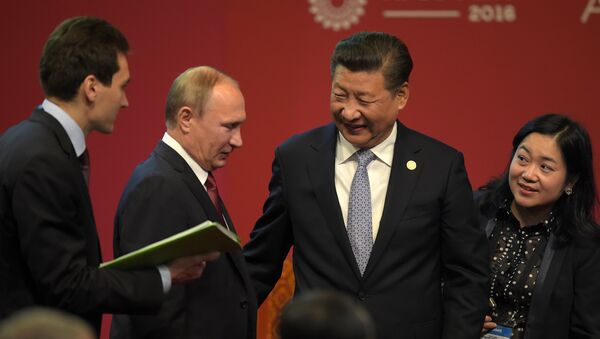 Russia's President Vladimir Putin (2nd L) and China's President Xi Jinping (2nd R) chat after shaking hands at the start of the ABAC and APEC Leaders' Dialogue at the Asia-Pacific Economic Cooperation Summit in Lima on November 19, 2016. - Sputnik International