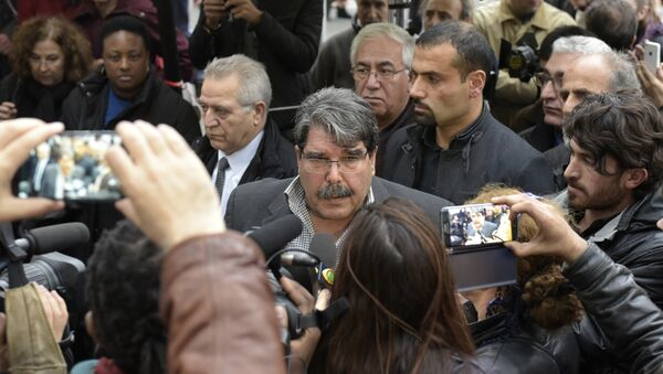 Salih Muslim Muhammad chairman of the PYD, the Syrian branch of the PKK answers journalists' questions as he arrives to pay tribute to the victims of the attacks claimed by Islamic State which killed at least 129 people and left more than 350 injured, on November 17, 2015 in front of the Bataclan theatrein Paris. (File) - Sputnik International