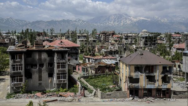 General view of damaged buildings after heavy fightings between Turkish government troops and Kurdish fighters after the curfew in the southeastern Turkey Kurdish town of Yuksekova, near the border with Iraq and Iran. (File) - Sputnik International