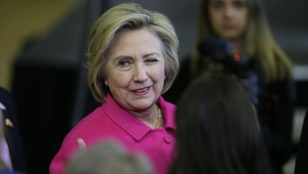 Democratic presidential candidate Hillary Clinton winks at a supporter after speaking at a campaign rally at the Iowa State Historical Museum in Des Moines, Iowa - Sputnik International