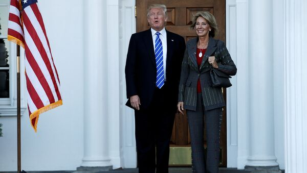 US President-elect Donald Trump (L) stands with Betsy DeVos after their meeting at the main clubhouse at Trump National Golf Club in Bedminster, New Jersey, US, November 19, 2016. - Sputnik International