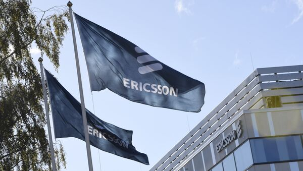 Flags with the logo of telecoms equipment maker Ericsson outside company's headquarters in Stockholm on October 4, 2016 - Sputnik International
