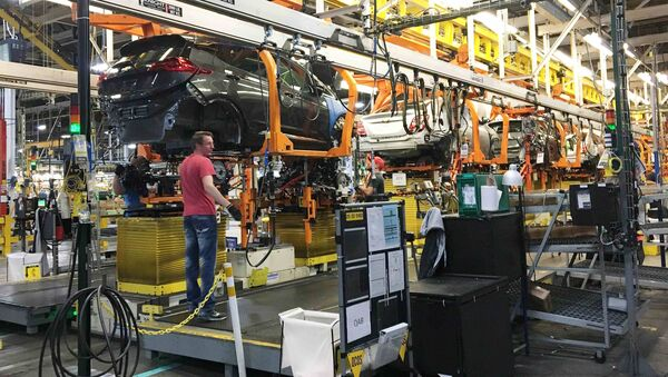Workers assemble Chevy Volt EV cars at the General Motors assembly plant in Orion Township, Michigan, U.S. November 4, 2016 - Sputnik International