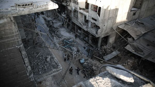 Syrians walk on a heavily damaged street on November 22, 2016, in the rebel-held town of Douma, on the eastern outskirts of the capital Damascus - Sputnik International