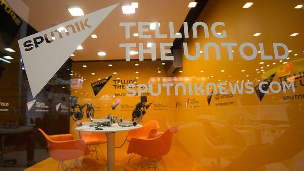 Стенд Международного информационного агентства Sputnik (Спутник) в ЭкспоФоруме перед открытием XX Санкт-Петербургского международного экономического форума - Sputnik International
