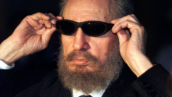 (FILES) This file photo taken on November 16, 1999 shows Cuban president Fidel Castro trying on a pair of sunglasses as he talks to the media 16 November 1999 in Havana, during the IX Iberoamerican Summit. Cuban revolutionary icon Fidel Castro died late Friday in Havana, his brother, President Raul Castro, announced on national television - Sputnik International