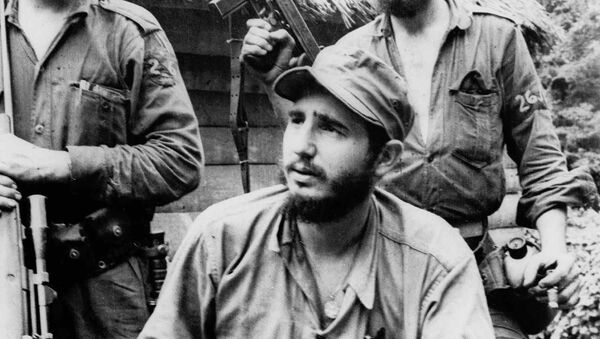 FILE - In this March 14, 1957 file photo, Fidel Castro, the young anti-Batista guerrilla leader, center, is seen with his brother Raul Castro, left, and Camilo Cienfuegos, right, while operating in the Mountains of Eastern Cuba. The man who nationalized the Cuban economy and controlled of virtually every aspect of life on the island celebrates his 90th birthday on Saturday - Sputnik International