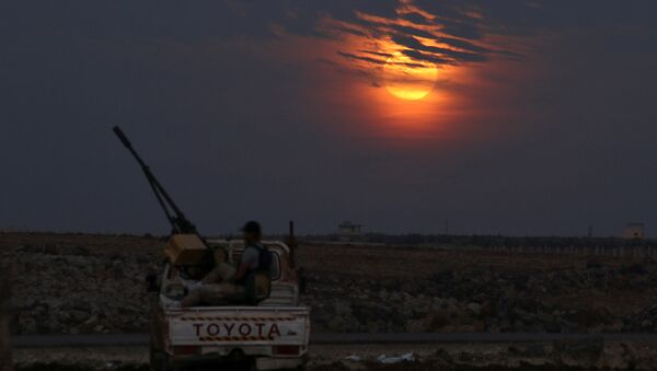 A Free Syrian army fighter sits on a pick-up truck mounted with a weapon, as the supermoon partly covered by clouds is seen in the background, in the west of the rebel-held town of Dael, in Deraa Governorate, Syria November 14, 2016 - Sputnik International