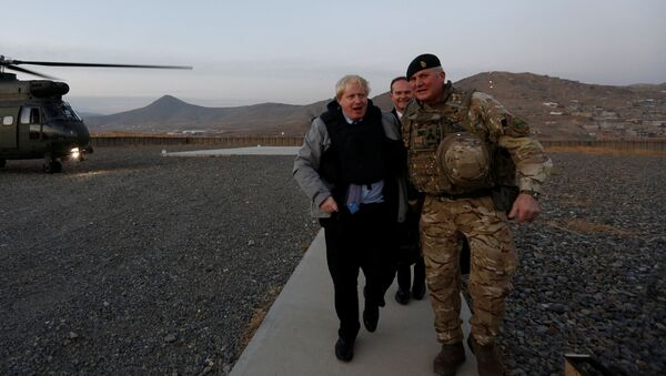 Britain's Foreign Secretary Boris Johnson (L) and Brigadier Ian Rigden, (R) Chief mentor At Afghan National Army Officer Academy arrives during his visits at Camp Qargha in Kabul, Afghanistan November 26, 2016 - Sputnik International