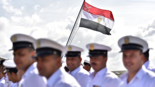 Egyptian soldiers stand as the Egyptian flag is raised on the BPC Anwar el Sadate military cruise ship during the flag ceremony on September 16, 2016 in Saint-Nazaire, western France - Sputnik International