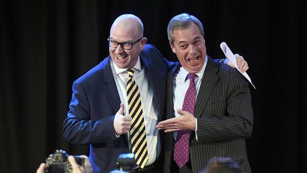 United Kingdom Independence Party (UKIP) interim leader Nigel Farage (R) embraces newly elected leader Paul Nuttall, in London, Britain November 28, 2016 - Sputnik International