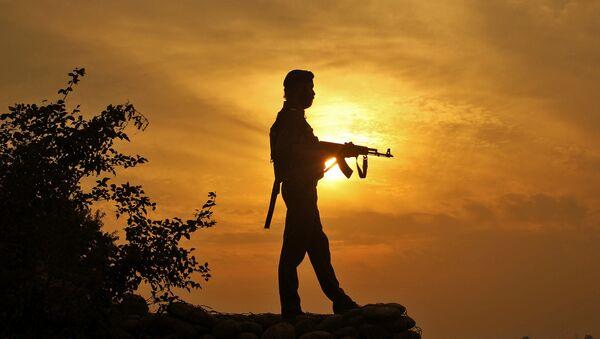 A policeman stands guard outside a police post near Jammu - Sputnik International