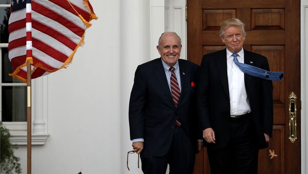 U.S. President-elect Donald Trump stands with former New York City Mayor Rudolph Giuliani before their meeting at Trump National Golf Club in Bedminster, New Jersey, U.S., November 20, 2016 - Sputnik International
