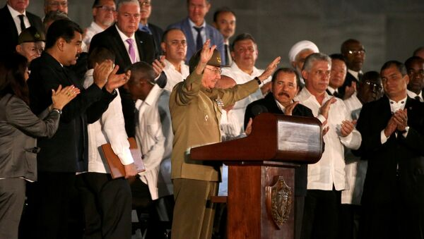 Cuban President Raul Castro acknowledges the applause from the crowd as he attends a massive tribute to Cuba's late President Fidel Castro in Revolution Square in Havana, Cuba, November 29, 2016. - Sputnik International