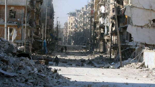 Syrians walk over rubble of damaged buildings, while carrying their belongings, as they flee clashes between government forces and rebels in Tariq al-Bab and al-Sakhour neighborhoods of eastern Aleppo towards other rebel held besieged areas of Aleppo, Syria. - Sputnik International