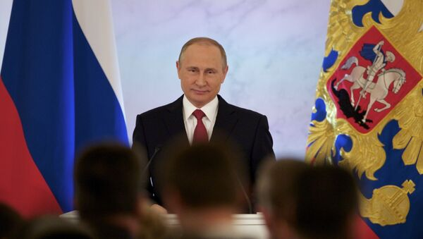 Russian President Vladimir Putin smiles as he gives his annual state of the nation address in the Kremlin in Moscow, Russia, Thursday, Dec. 1, 2016. - Sputnik International