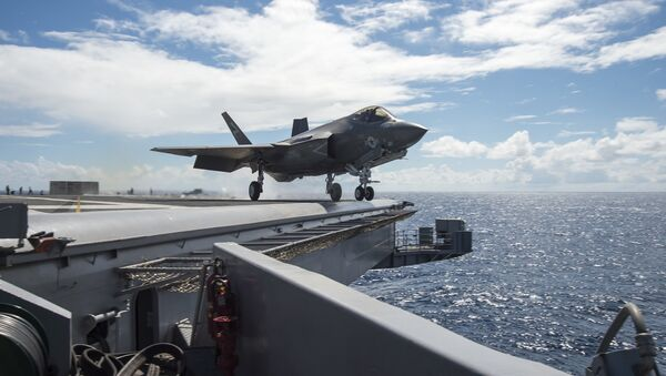 An F-35C Lightning II carrier variant joint strike fighter assigned to the Salty Dogs of Air Test and Evaluation Squadron (VX) 23 launches off the flight deck of the aircraft carrier USS Dwight D. Eisenhower (CVN 69). - Sputnik International