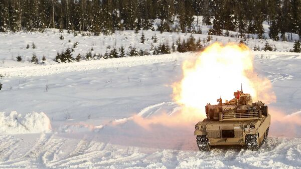 A M1A1 Abrams Tank fires its main gun as it takes part in a live-fire exercise in Rena, Norway, Feb. 18, 2016 - Sputnik International