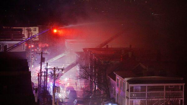 Firefighters battle a multi-alarm fire in a residential area of Cambridge, Massachusetts, U.S., December 3, 2016. - Sputnik International