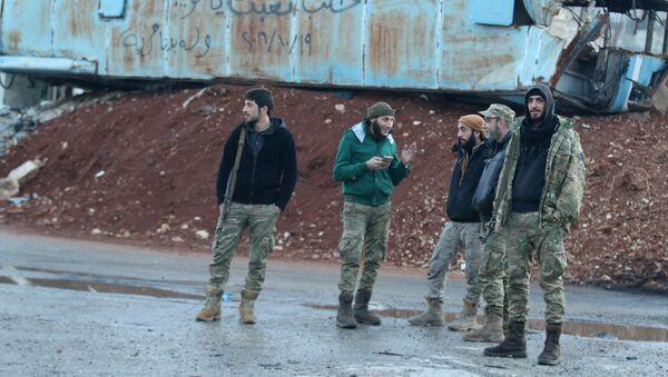 Rebel fighters stand near a damaged bus used as a barricade in the rebel-held besieged Bab al-Hadid neighbourhood of Aleppo, Syria December 2, 2016 - Sputnik International