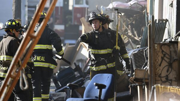 Firefighters assess the scene where a deadly fire tore through a late-night electronic music party in a warehouse in Oakland, Calif., Saturday, Dec. 3, 2016. Officials described the scene inside the warehouse, which had been illegally converted into artist studios, as a death trap that made it impossible for many partygoers to escape the Friday night fire. - Sputnik International