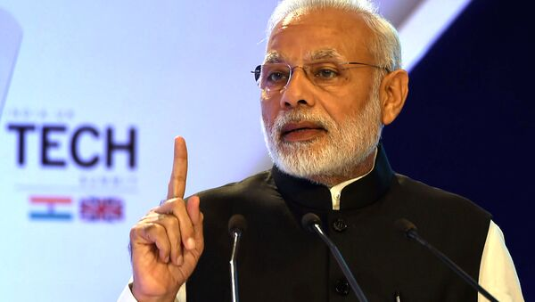 India's Prime Minister Narendra Modi gestures as he speaks at The India-UK Tech Summit in New Delhi on November 7, 2016 - Sputnik International
