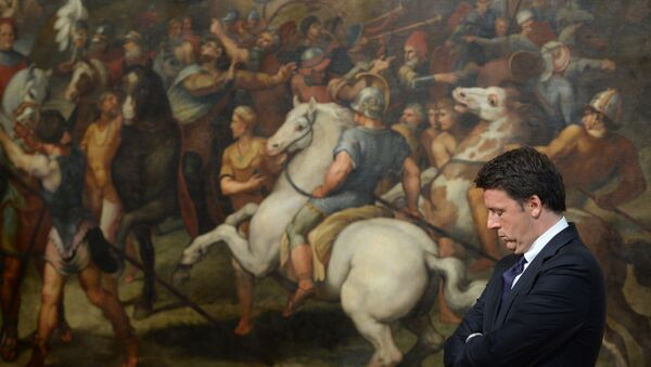 (FILES) This file photo taken on June 23, 2016 shows Italian Prime Minister Matteo Renzi standing in front of a copy of a fresco by Italian artist Raphael named The Meeting of Leo I and Attila, on June 23, 2016 at the Palazzo Chigi in Rome - Sputnik International