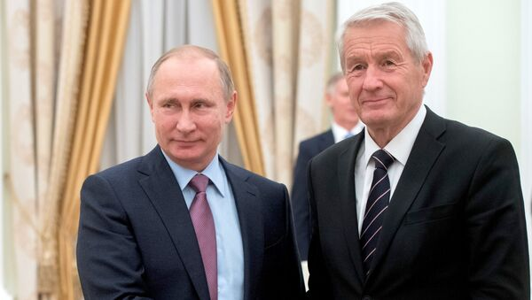 Russian President Vladimir Putin shakes hands with Council of Europe Secretary General Thorbjorn Jagland during their meeting at the Kremlin in Moscow, Russia - Sputnik International