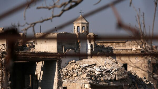 A part of a church is seen amid the damage in the government-controlled area of the Old City of Aleppo, Syria December 10, 2016 - Sputnik International