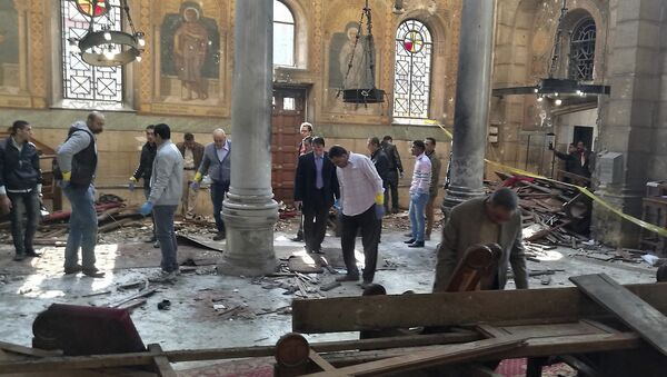 Egyptian security forces examine the scene inside St. Mark Cathedral in central Cairo, following a bombing, Sunday, Dec. 11, 2016 - Sputnik International