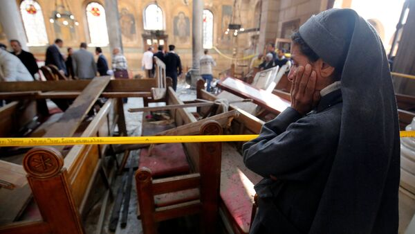 A nun cries as she stands at the scene inside Cairo's Coptic cathedral, following a bombing, in Egypt December 11, 2016 - Sputnik International