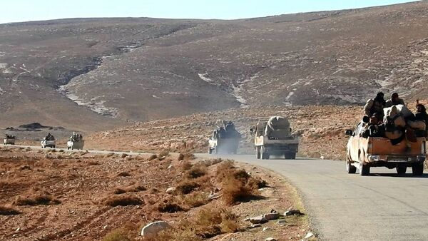 This image posted online on Saturday, Dec. 10, 2016, by supporters of the Islamic State militant group on an anonymous photo sharing website, purports to show a convoy of Daesh vehicles driving in a desert area of east of Palmyra city, in Homs, Syria - Sputnik International