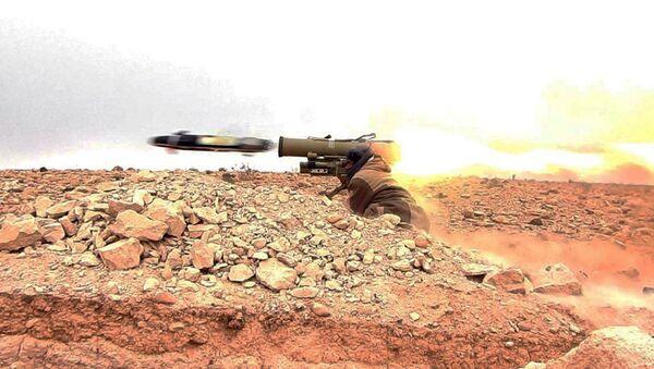 Daesh gunman firing an anti-tank missile at Syrian troops north of Palmyra city, in Homs Provence, Syria (File) - Sputnik International