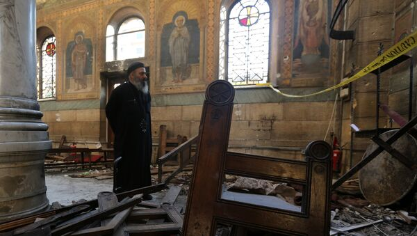 A Coptic priest stands at the scene following a bombing inside Cairo's Coptic cathedral in Egypt December 11, 2016 - Sputnik International