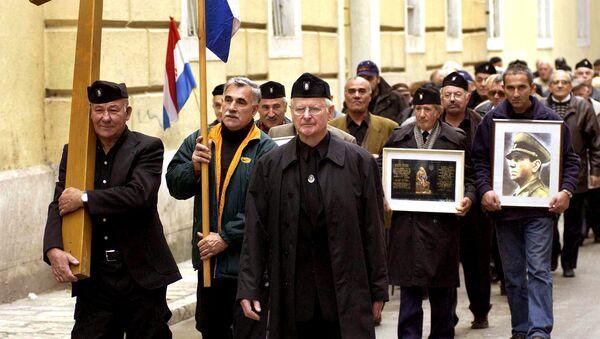 A group of mostly older Croatians, wearing Second World War Ustasha regime uniforms, parade in the Croatian Adriatic resort of Zadar, carrying a portrait of the late Ustasha leader, Ante Pavelic (R), 07 December 2004 - Sputnik International