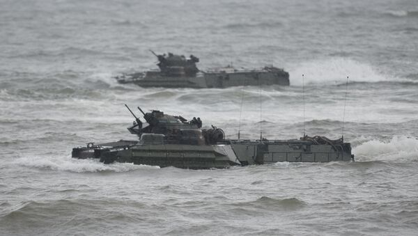 US marines Amphibious Assault vehicles (AAV) manoeuver on rough seas during a beach landing, as part of the Philippines-US amphibious landing exercise (PHIBLEX) at a naval training base facing South China sea in San Antonio town, Zambales province, north of Manila on October 7, 2016 - Sputnik International